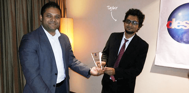 Sk. Tajbir receiving Employee of the Year 2013 award from Desme's CEO Enam Noor